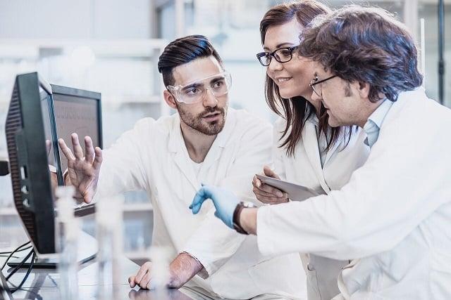 3 scientist at computer 50%